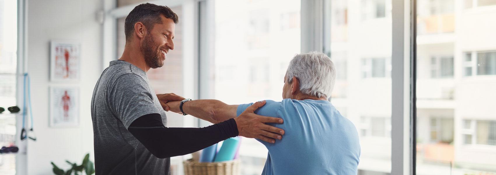 An elderly man receiving rehabilitation services at his senior living community