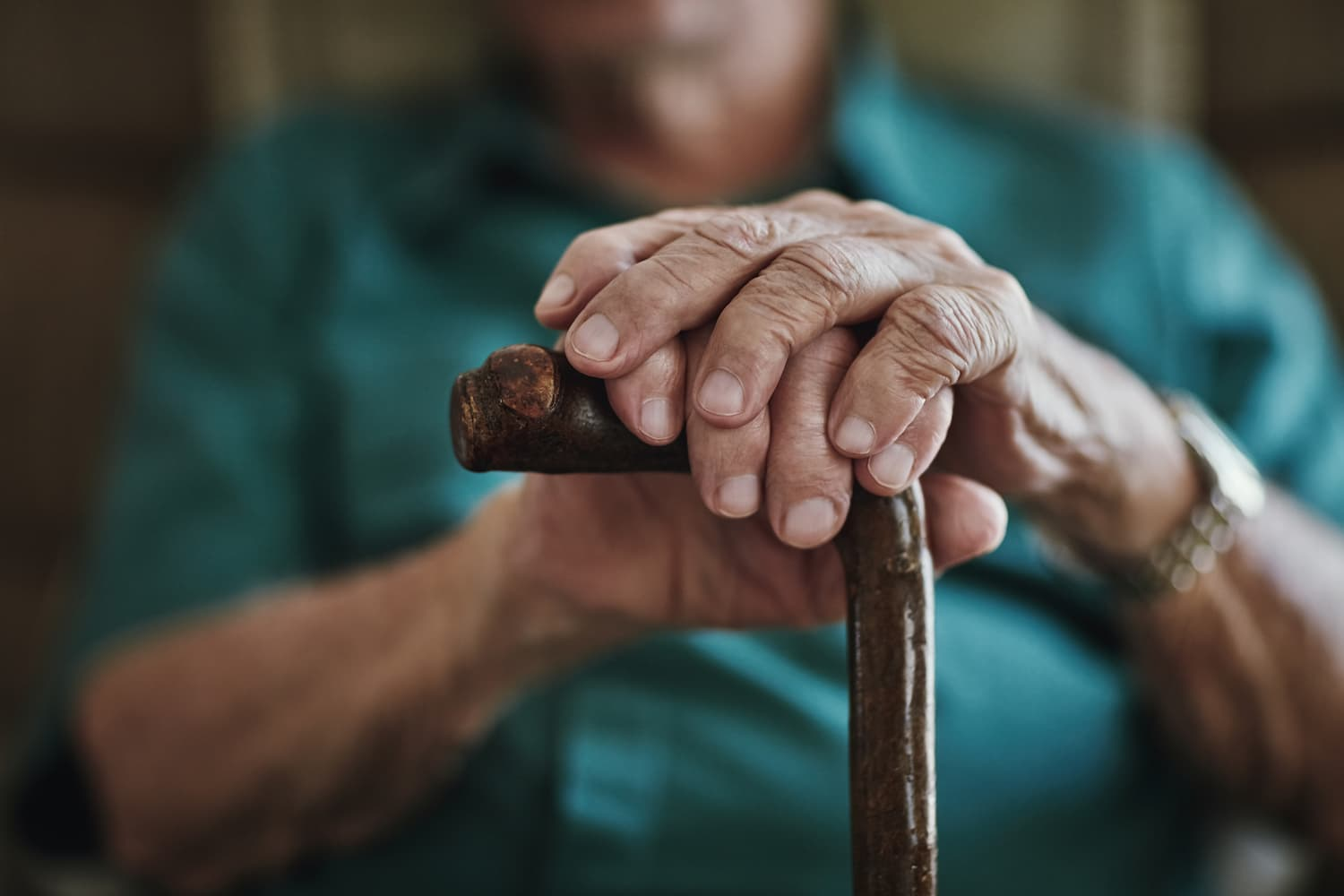 Close-up of hands and cane